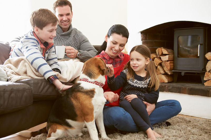 family with pet staying warm